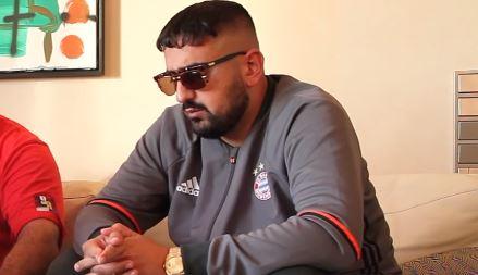 Haftbefehl mit Sonnenbrille im Interview